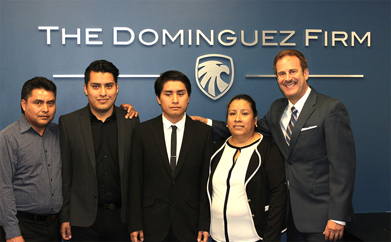 Attorney Juan Dominguez with the Perez family