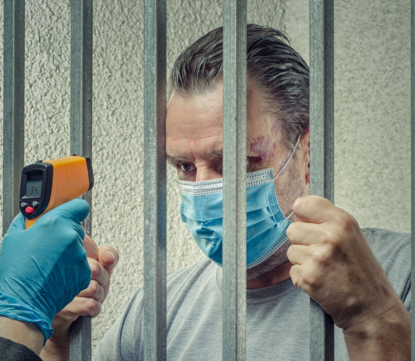 Prisoner Measuring Temperature  By Thermometer